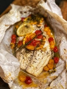 a piece of baked fish in parchment paper