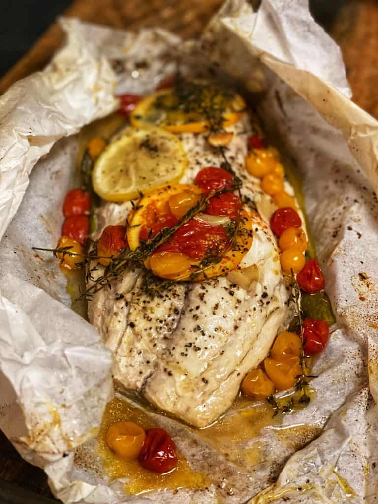 a piece of red snapper steamed in parchment paper