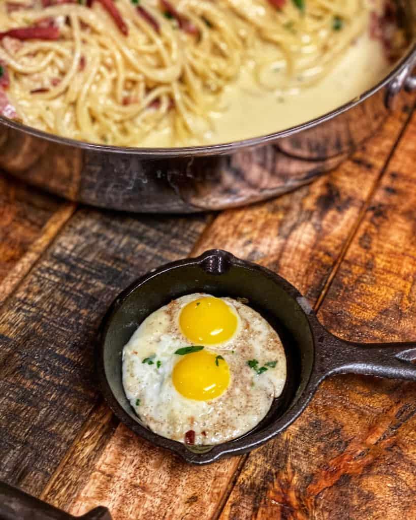 two fried quail eggs in a mini Lodge cast iron pan