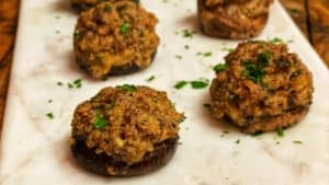a plate of sausage stuffed mushrooms