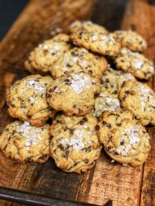 Salted chocolate chip cookies on a wooden board
