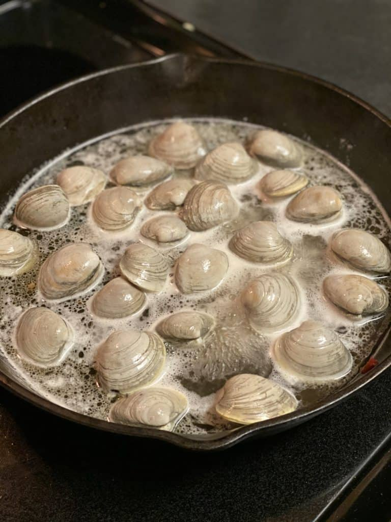 clams steaming in white wine for my clams with crispy country ham