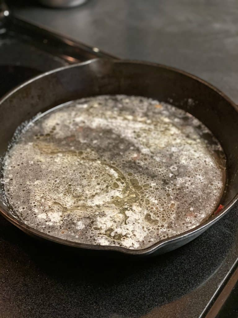 wine and butter in a cast iron pan
