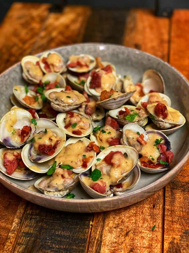 a bowl of Clams with Crispy Country Ham and Maple Apple Foam