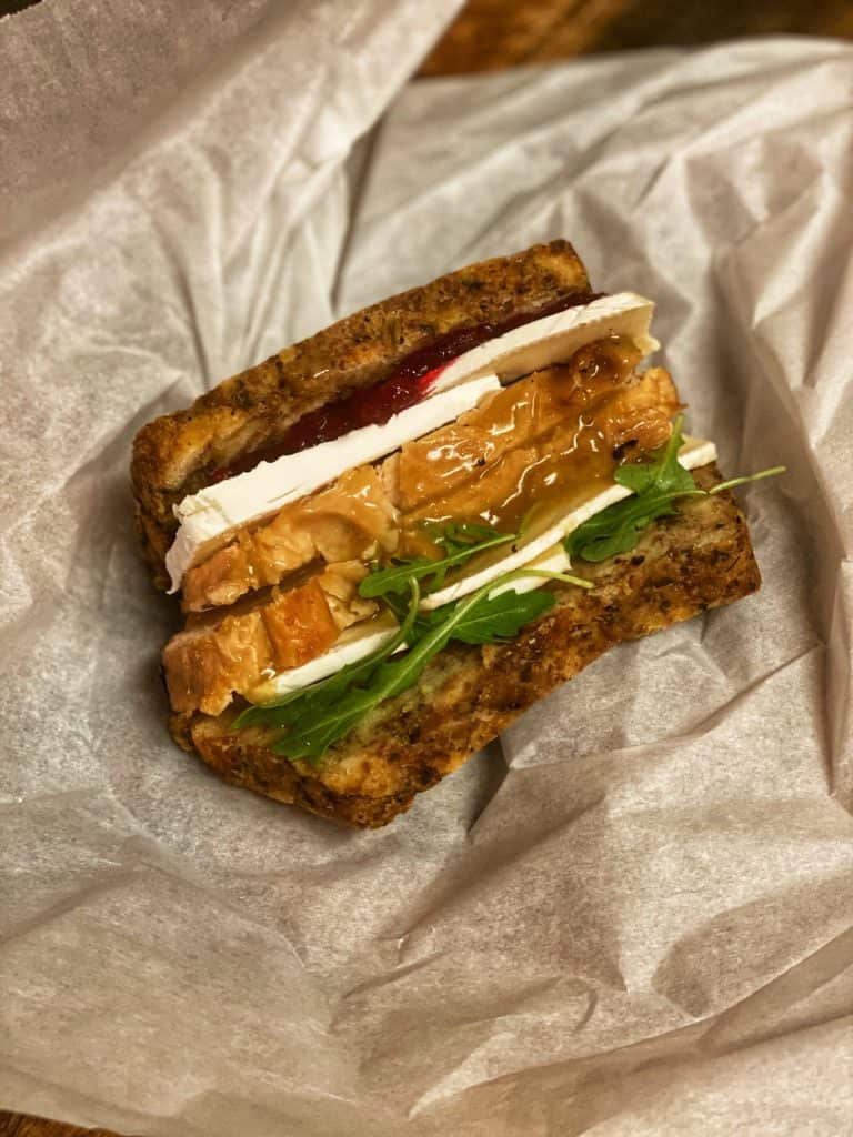 leftover turkey sandwich with stuffing, turkey, brie and arugula