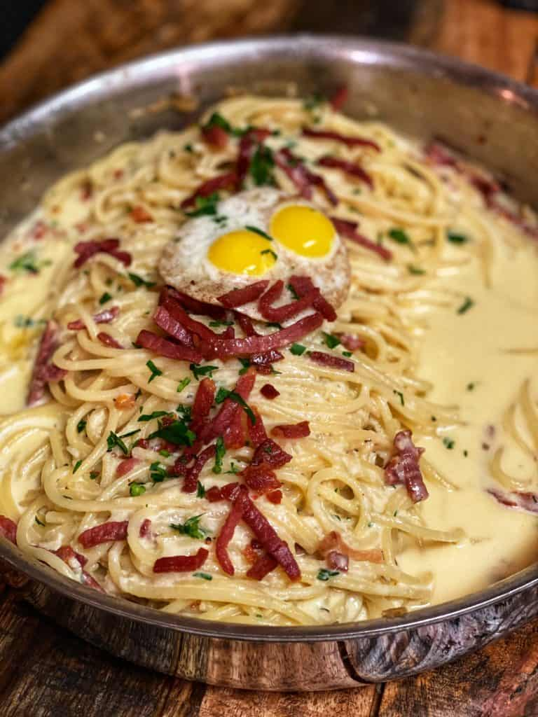 a pan of pasta carbonara with country ham and quail eggs