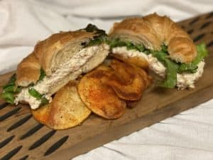 Chicken salad on a croissant with homemade chips