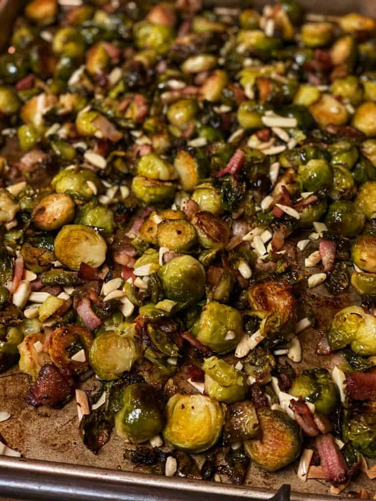 a pan of roasted Brussels sprouts with bacon and almonds