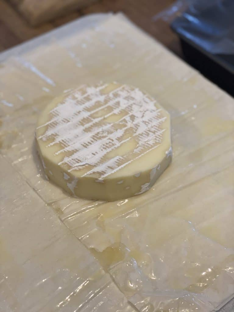 a wheel of brie cheese on phyllo dough