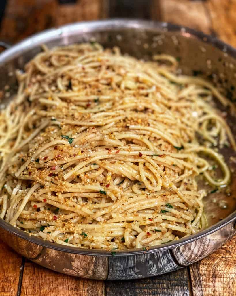 a pan of pasta with anchovies and breadcrumbs