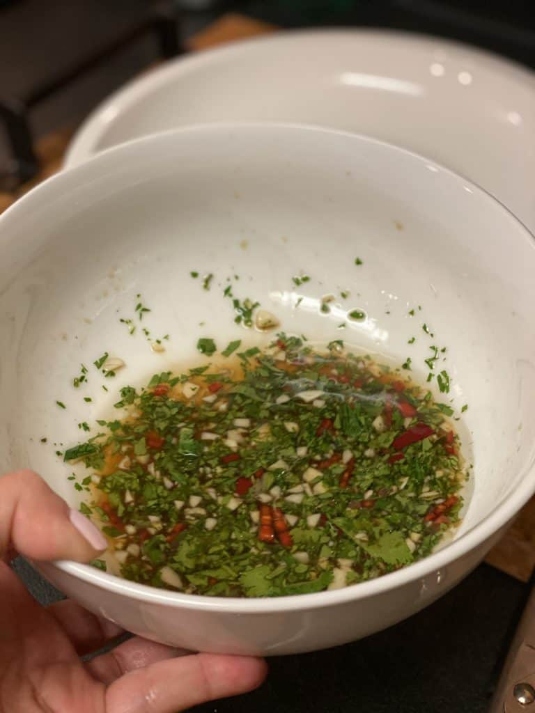 Thai-style sauce in a white bowl