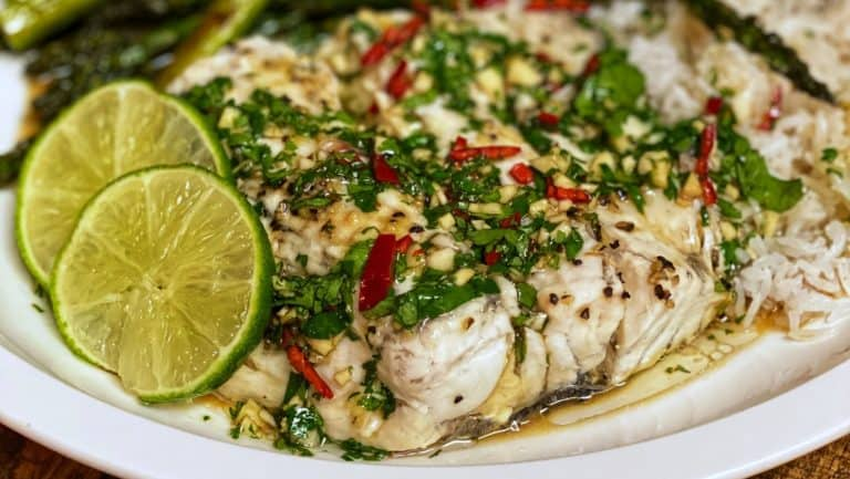 A plate of Thai-Style Steamed Barramundi with steamed rice and roasted asparagus