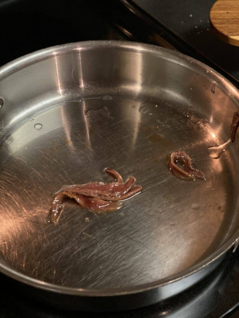 anchovies melting in a pan