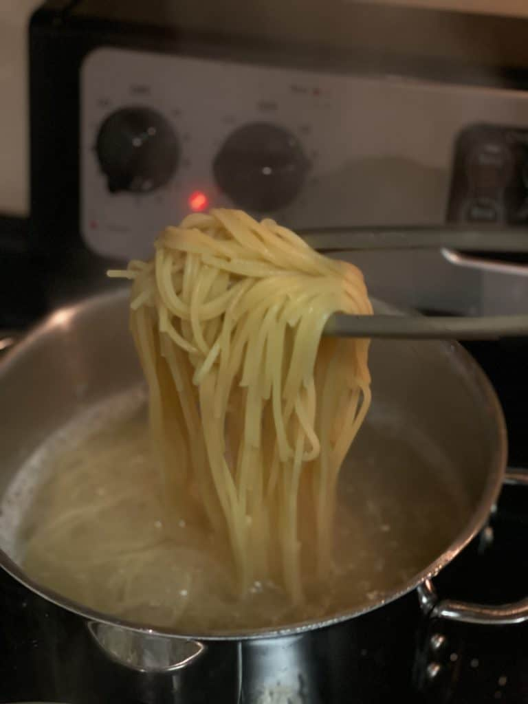 a tong full of spaghetti