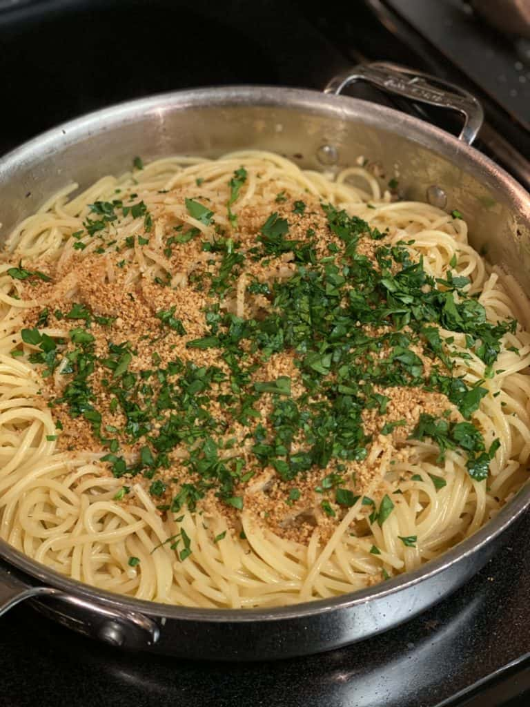 breadcrumbs and parsley on spaghetti
