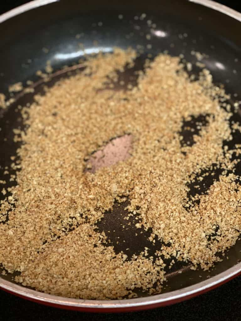 breadcrumbs browning in a pan