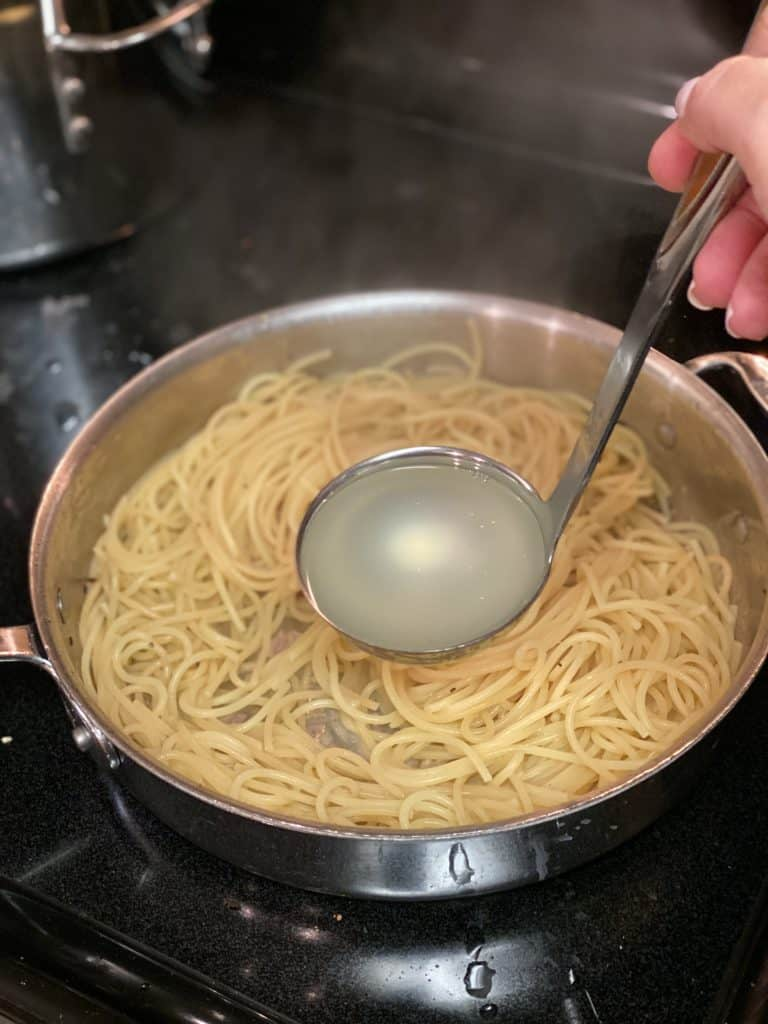 a ladle of pasta water