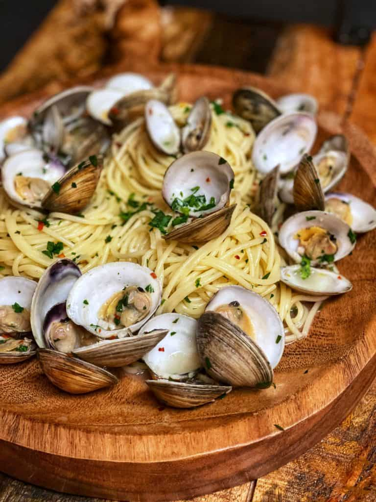 spaghetti and clams in a wooden bowl