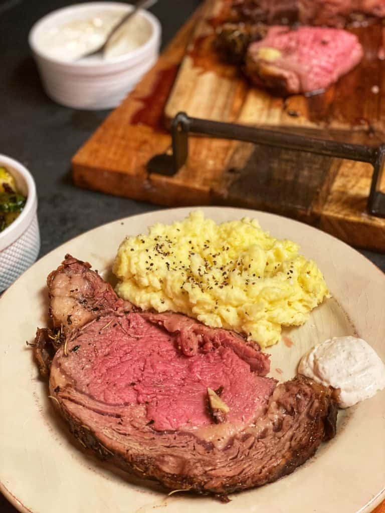 a plate of the perfect prime rib with mashed potatoes