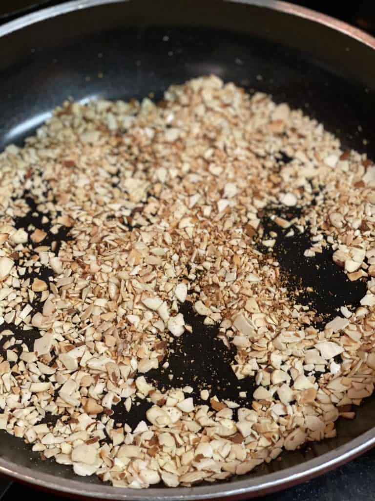 crushed almonds browned in a pan for my toasted almond cheese ball