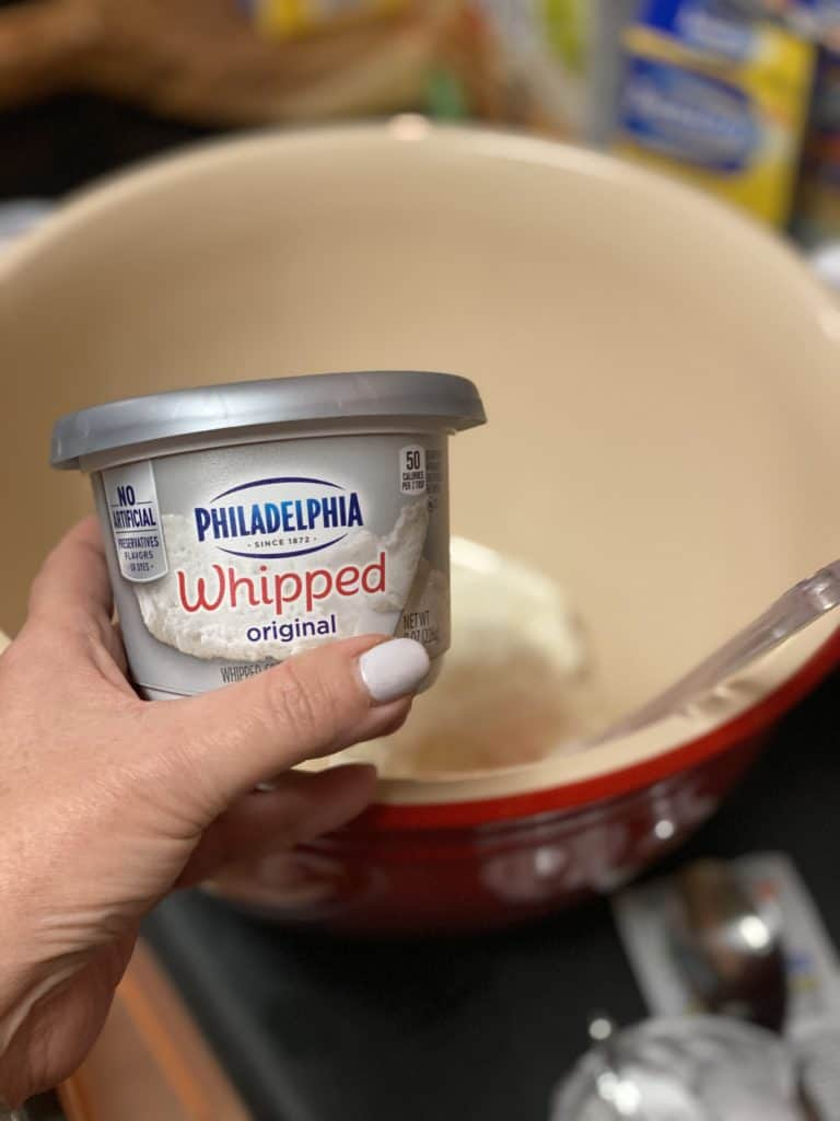a container of Philadelphia cream cheese for my toasted almond cheese ball