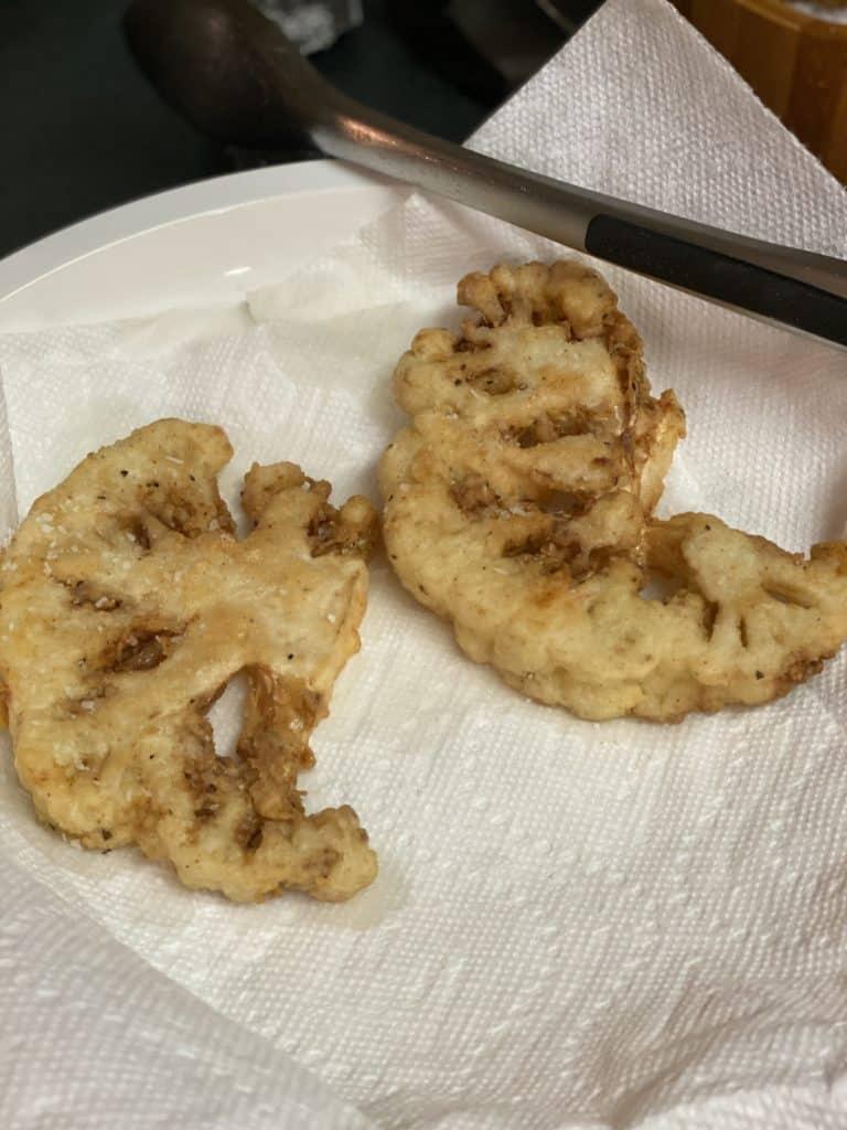 buttermilk fried cauliflower draining on paper towels