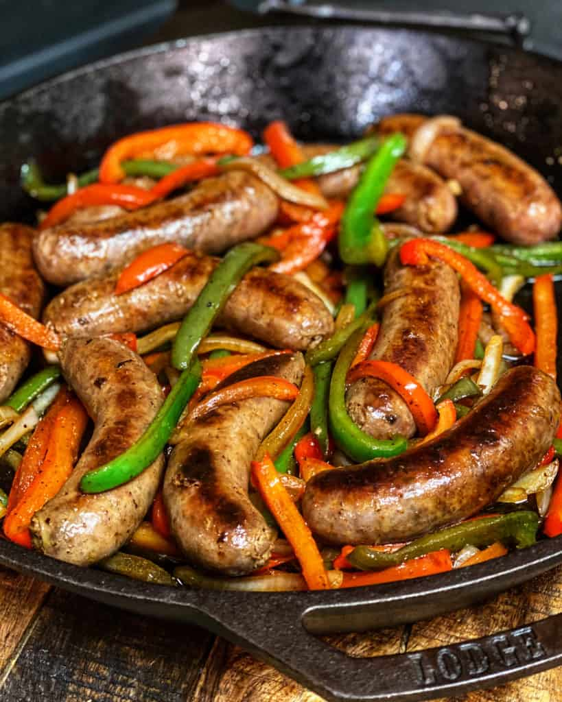 a cast iron pan full of sausage and peppers
