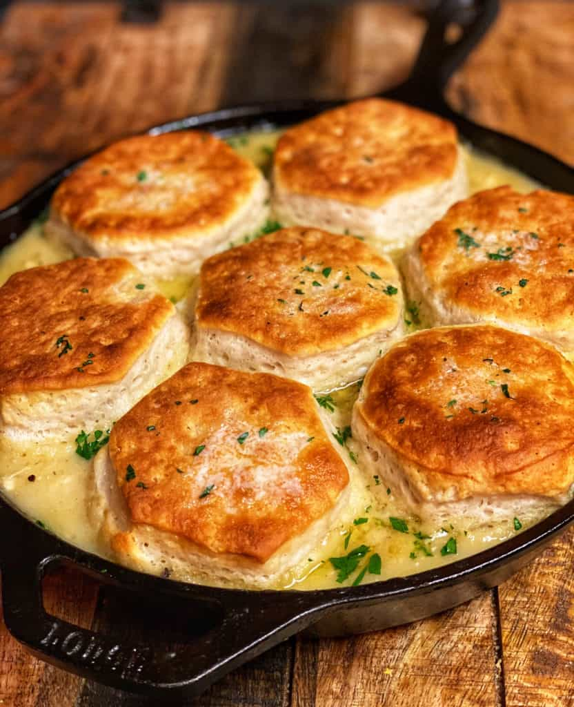 a cast iron pan of creamed chicken and biscuits
