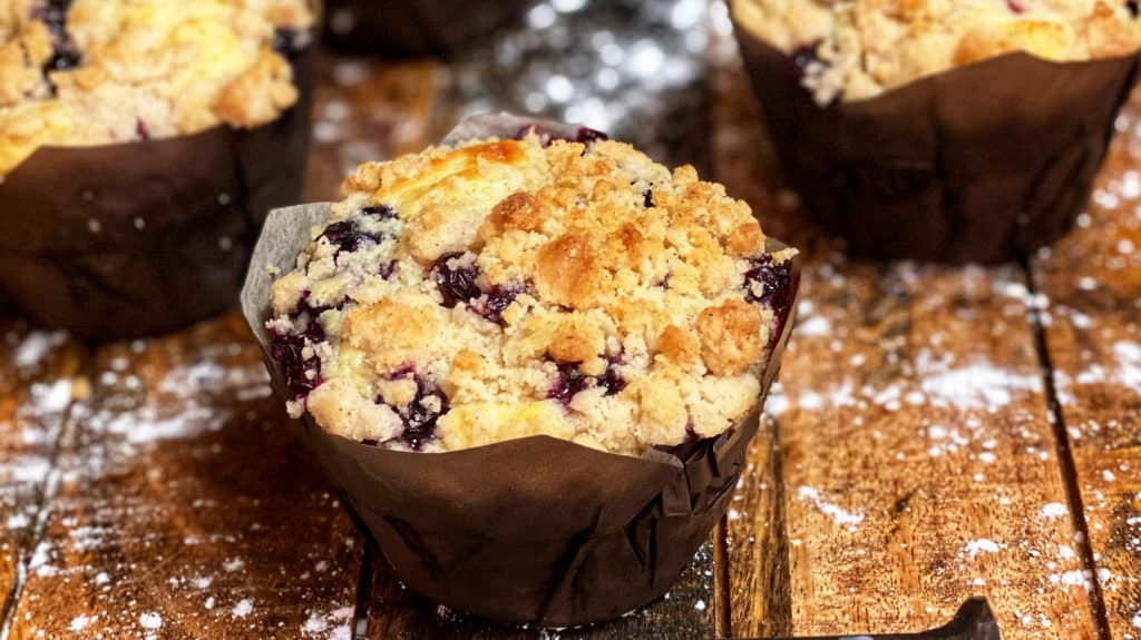blueberry muffins on a wooden board