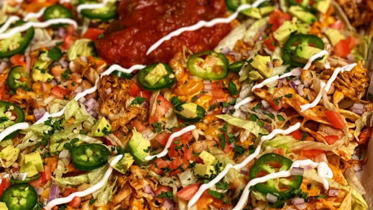 a sheet pan of loaded chicken nachos
