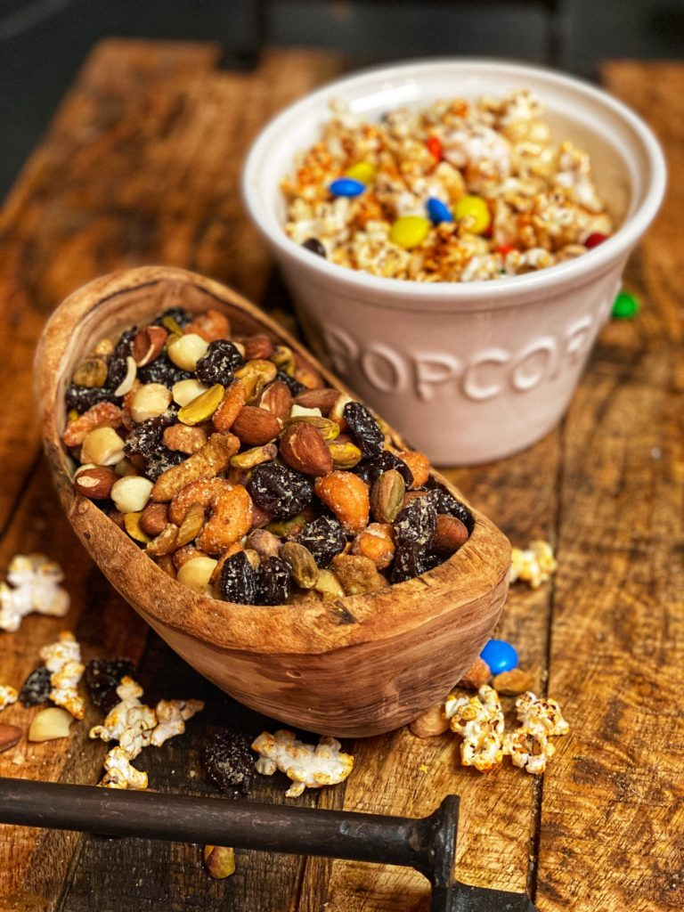 a bowl of mixed nuts and a bowl of popcorn