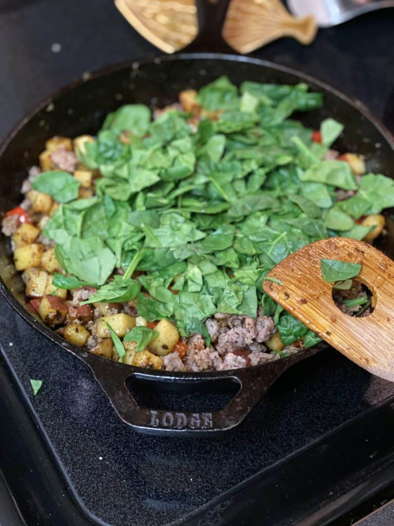 spinach in a cast iron pan