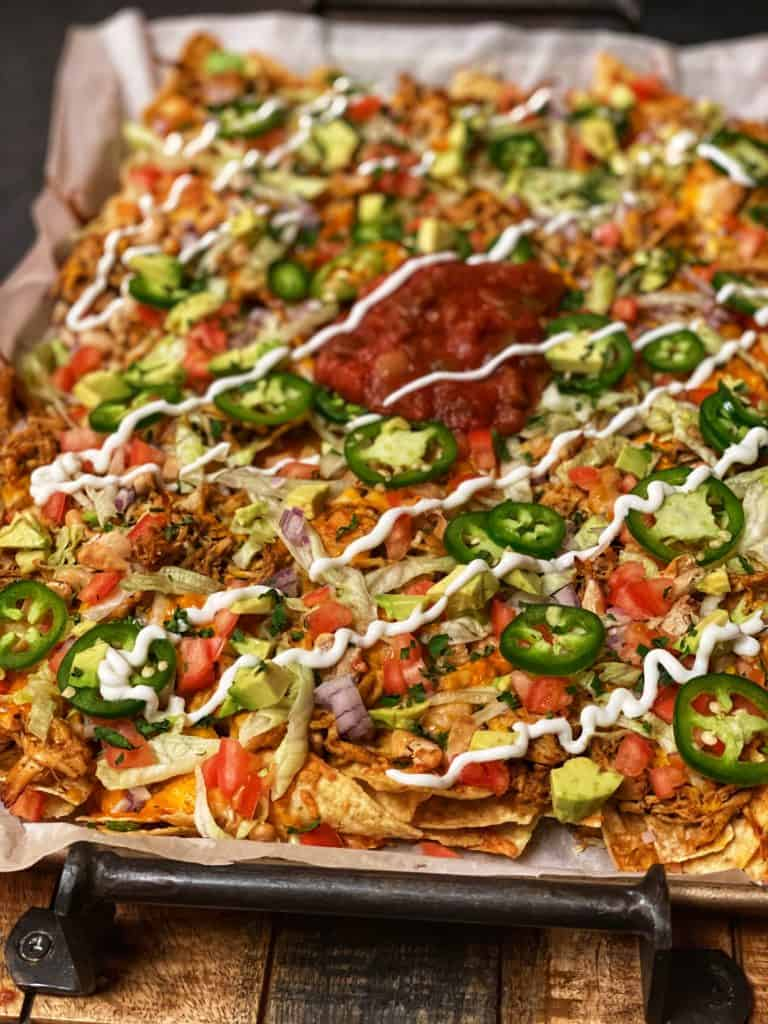 a sheet pan of loaded chicken nachos