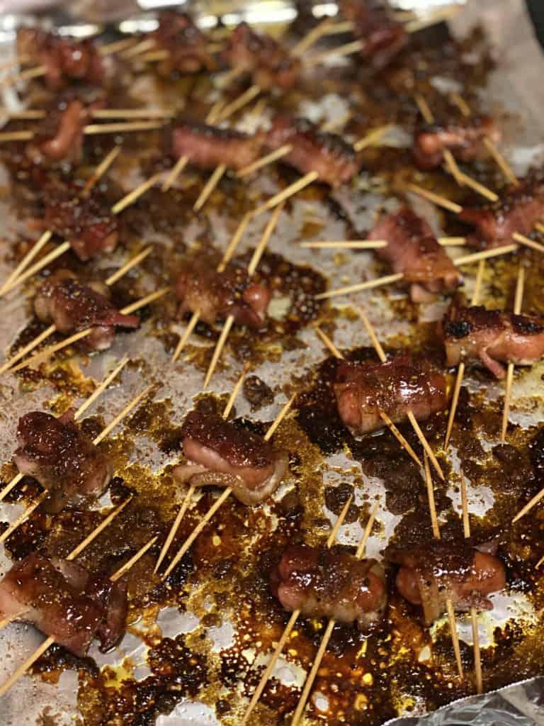 a sheet pan of bacon wrapped smokies