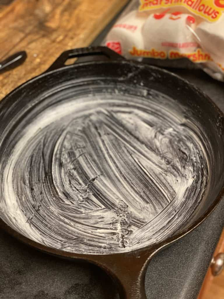 cast iron pan lined with butter