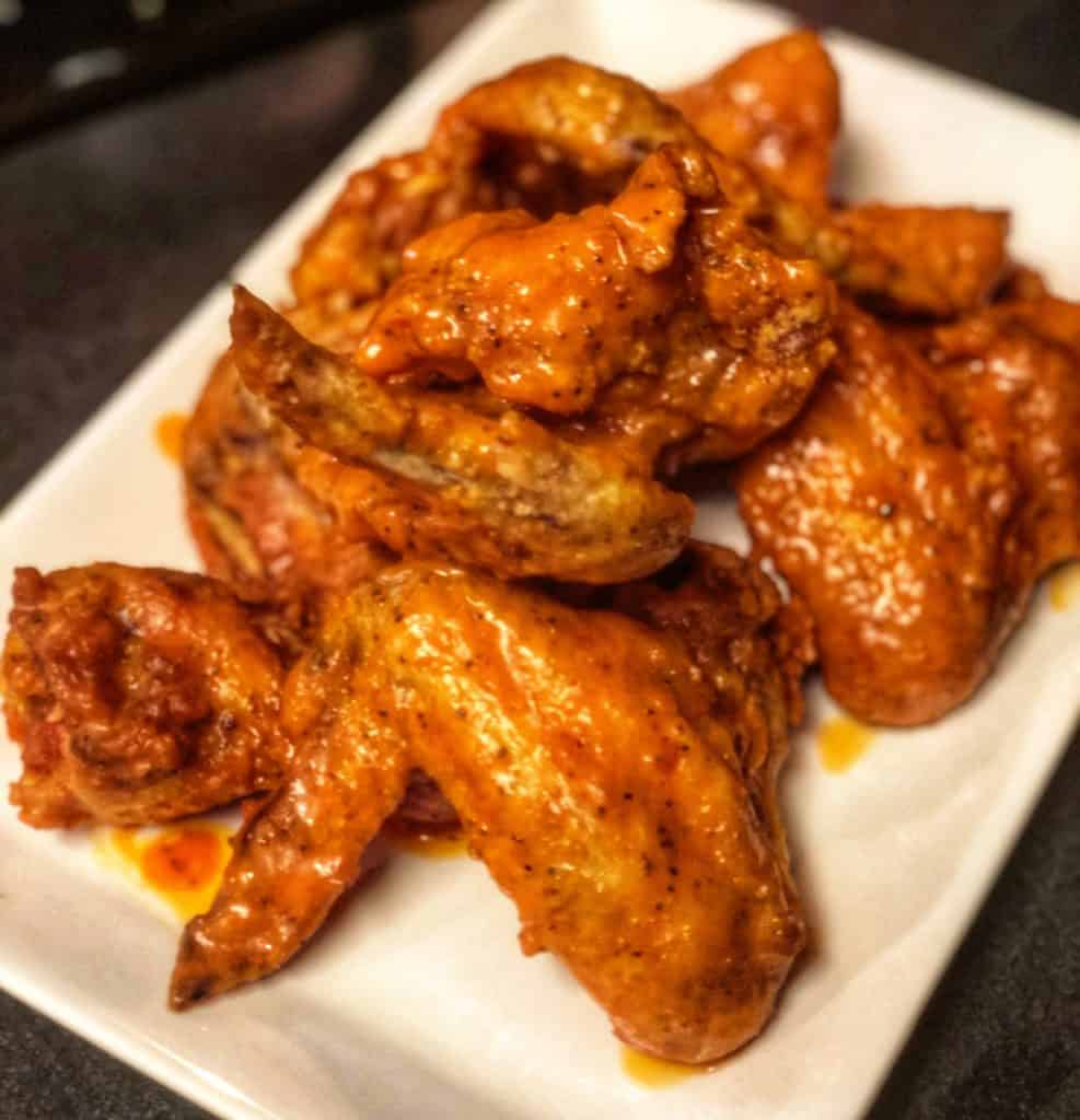 a plate of buffalo chicken wings for my super bowl party food blog