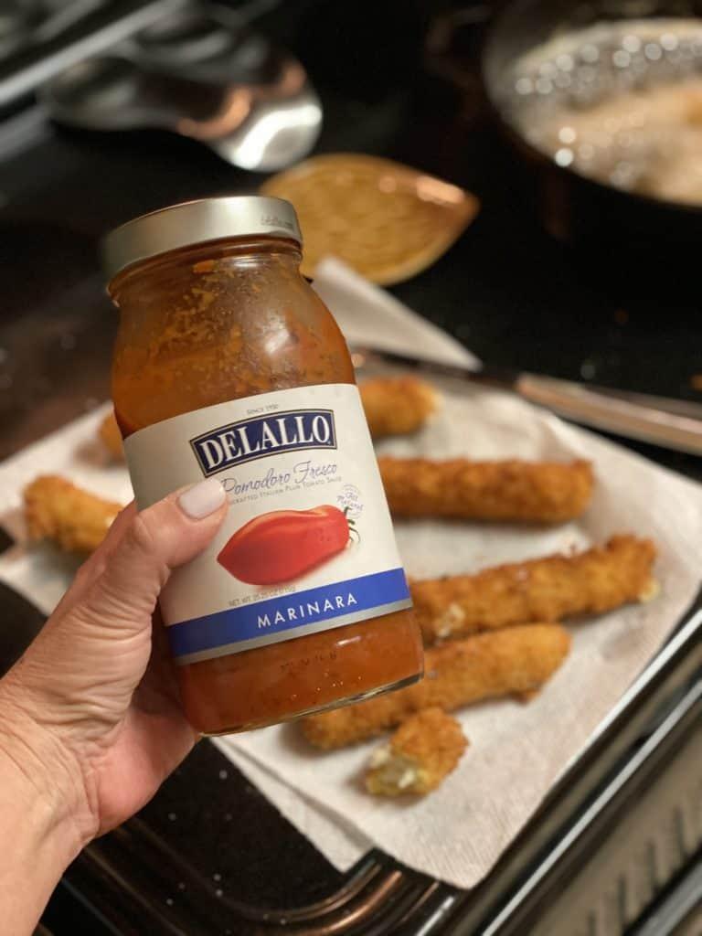 a jar of Delallo marinara sauce for fried mozzarella sticks