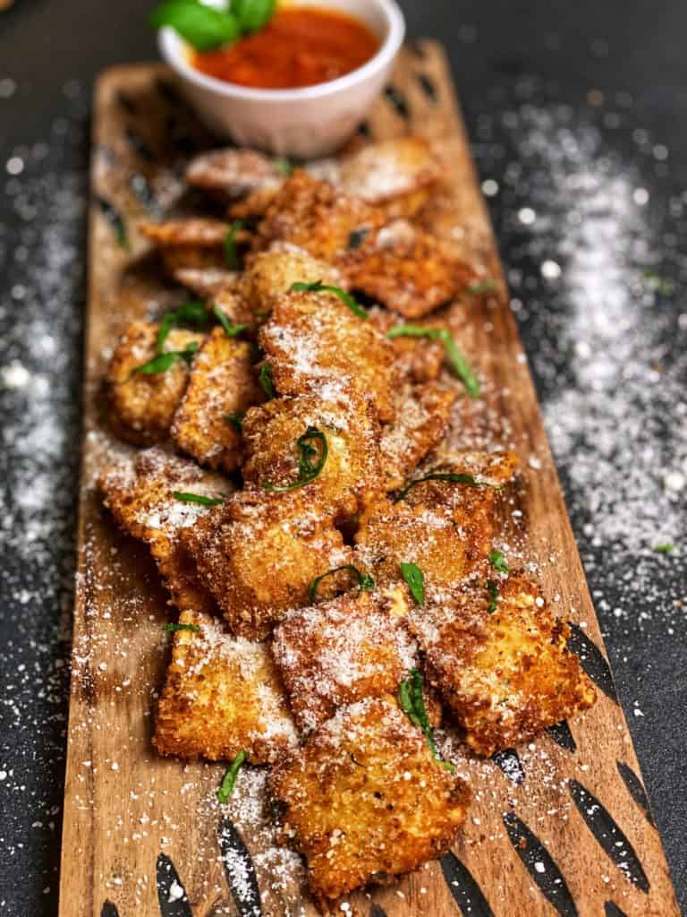 a plate of deep fried toasted ravioli