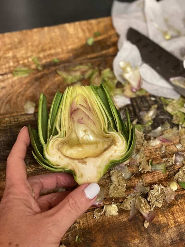 one half of a cleaned out artichoke
