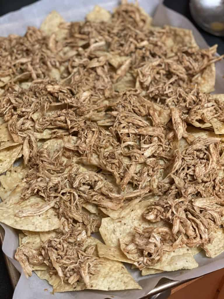 shredded chicken on tortilla chips