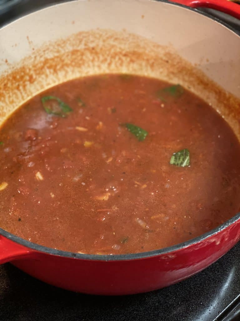 a pot of tomato sauce for braciole