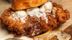 crispy chicken sandwich with ice cream and honey