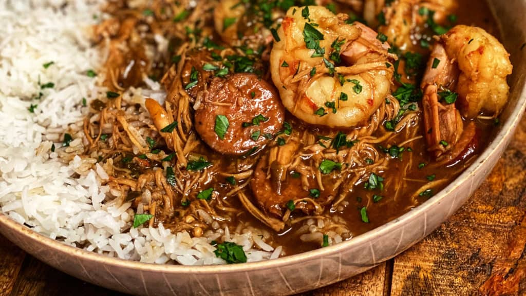 a bowl of gumbo and rice