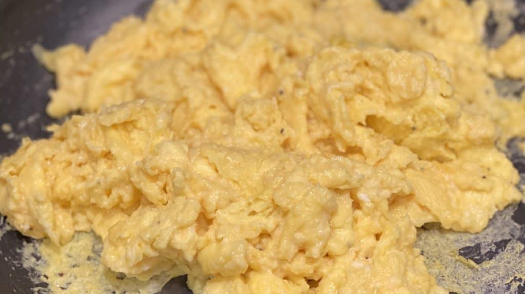 a pan of scrambled eggs