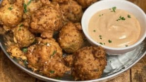 a plate of conch fritters