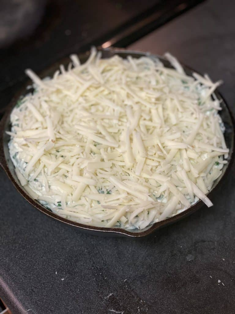spinach artichoke dip in a cast iron pan