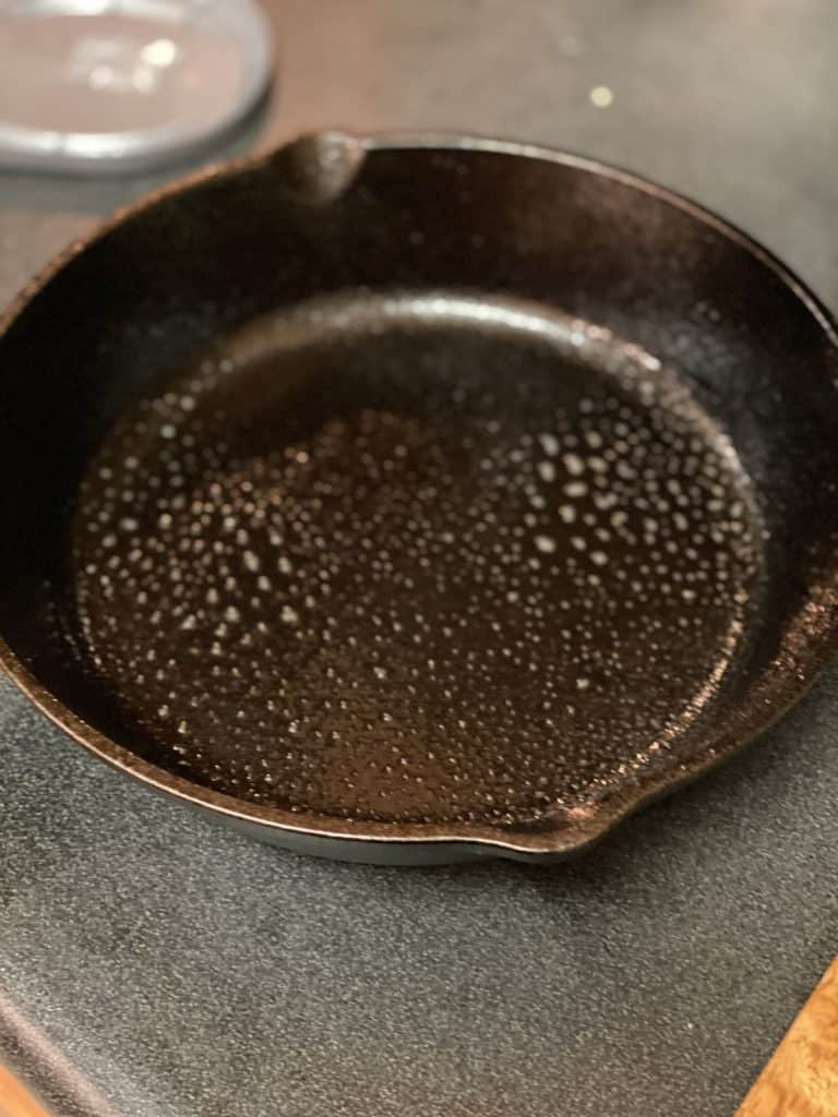 an oiled cast iron pan