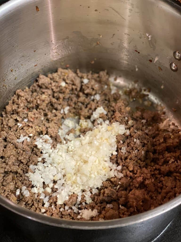 ground meat and onions in a pot