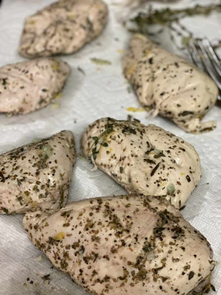 six sous vide chicken breasts on paper towels