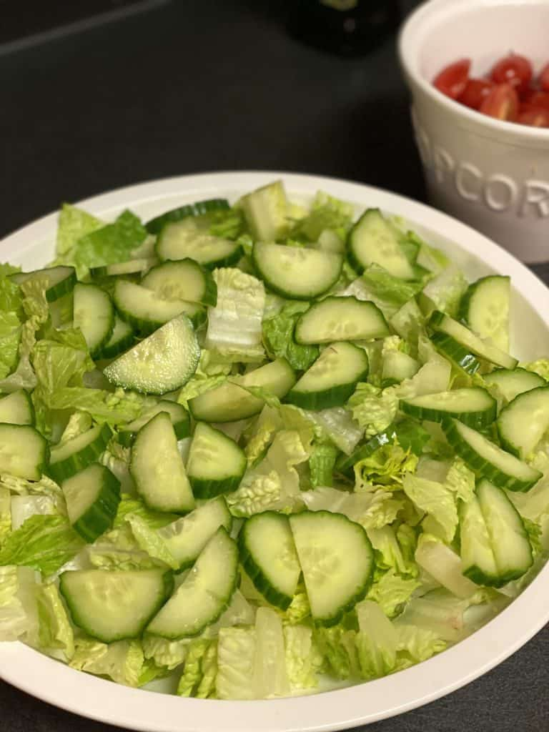 a plate of chopped romaine and cucumbers